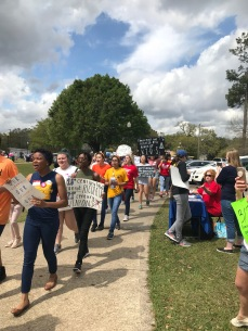 Student marchers with signs at the March for Our Lives in Mobile AL